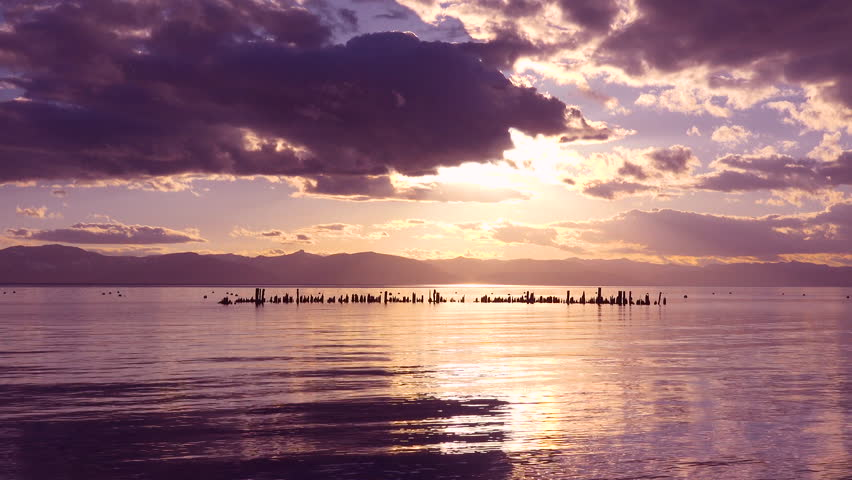 GLENBROOK, LAKE TAHOE, NEVADA - CIRCA 2017 - A beautiful sunset behind abandoned pier pilings at Glenbrook, Lake Tahoe, Nevada.