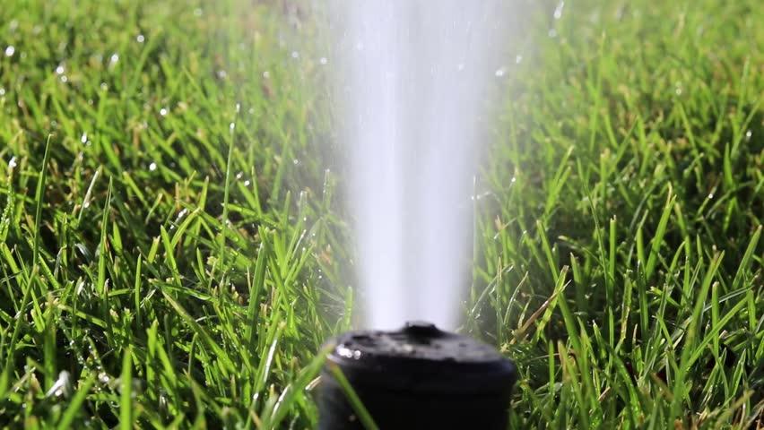 Saratoga Springs, UT / United States - 06 09 2018: Front Yard Sprinkler