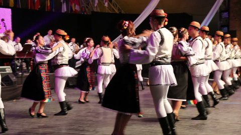 TIMISOARA, ROMANIA - JULY 7, 2016: Young Romanian dancers in traditional costume, perform folk dance during International Festival of hearts organized by the City Hall Timisoara.