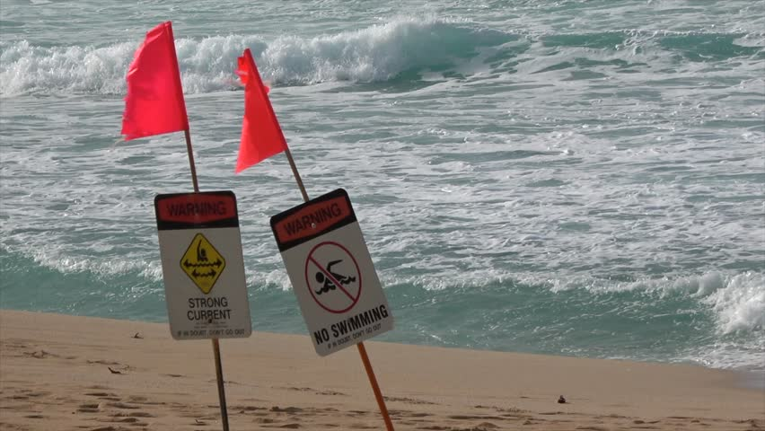 044cb90f551c Beach signs and red flags filmed in slow motion. Ocean Safety and Lifeguard  Services. hazardous conditions