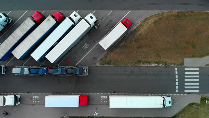 trucks in the parking lot, shot from the drone in 4k