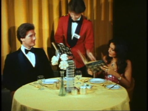 QUEEN ELIZABETH 2, 1982, Columbia Dining Room, formal dress couple with waiter