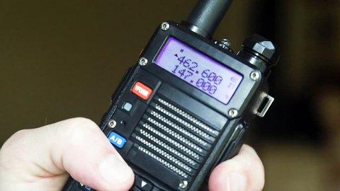 Hand using Amateur Radio Walkie Talkie