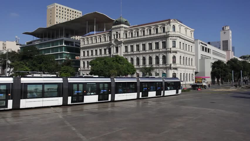 Tram passes Museum Quarter Square with Museum of Art of Rio de Janeiro in the background #1013562059