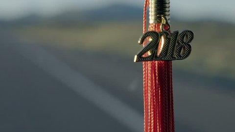 2018 Graduation Tassel Hanging From the Rearview Mirror In A Car