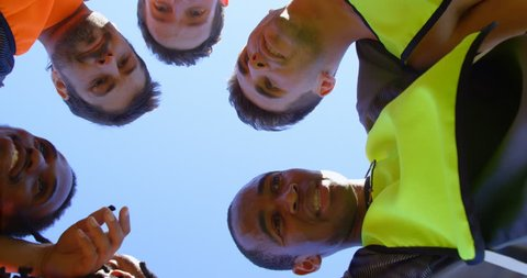 Close-up of soccer players forming a huddle 4k