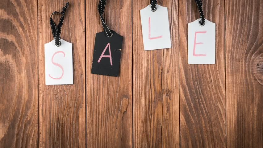 Sale on wooden label tags. Advertisement for a sale. Motion background with hanging price tags with Sale labels, stop motion, animation. Shopping sales and promotions concept | Shutterstock HD Video #1013605709