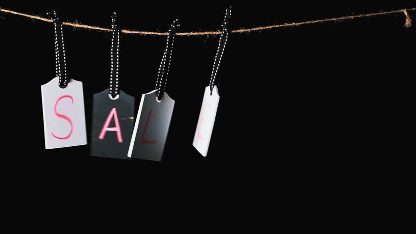 Sale on wooden label tags.Tags with black background. Advertisement for a sale. Motion background with hanging price tags with Sale labels, slow motion. Shopping sales and promotions concept. | Shutterstock HD Video #1013605799