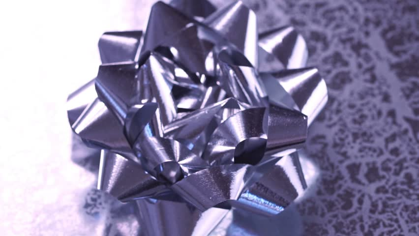 Ultra violet bow on gift box, closeup. Rotate