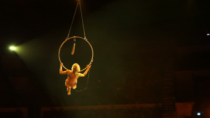 Young girl performs the acrobatic elements in the air ring | Shutterstock HD Video #1013656559