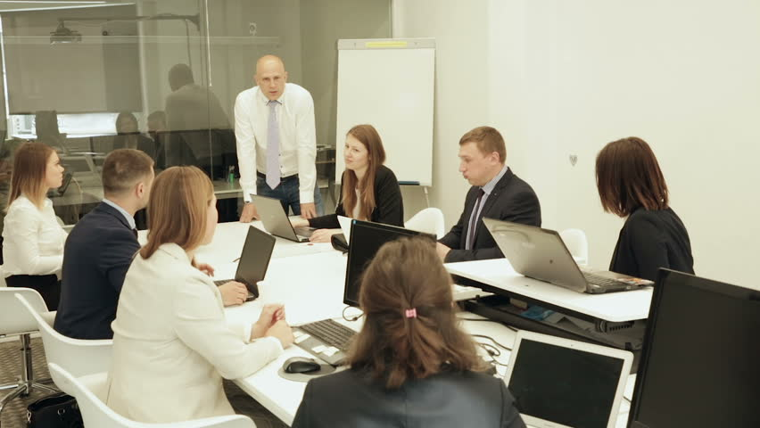 Confident successful businessman discussing new business project with members of his team | Shutterstock HD Video #1013685869