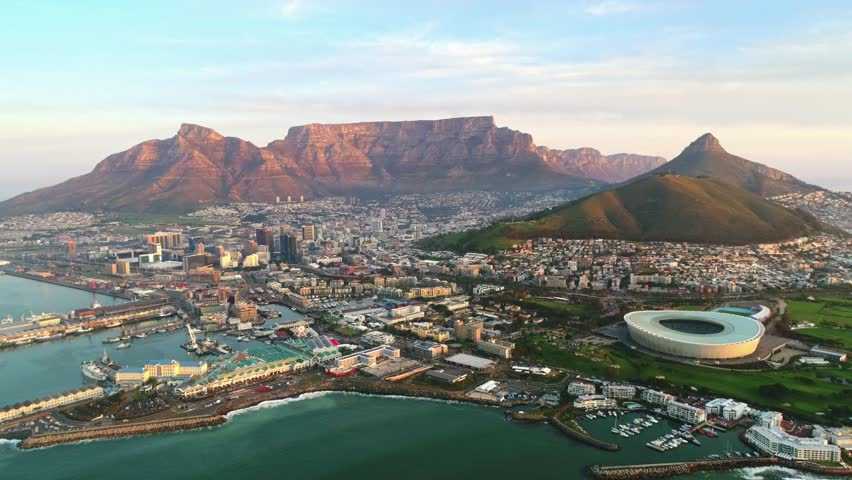 Aerial view flying towards the city of Cape Town with Table Mountain as a backdrop
