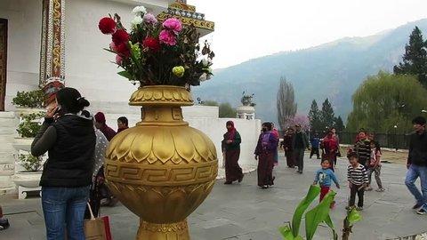 Thimphu, Bhutan - 03 22 2015: Devotees walk the circumference of the National Memorial Chorten in Thimpu, Bhutan