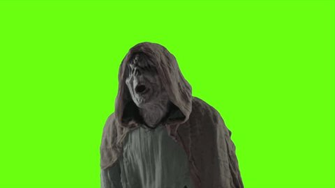 A scary monster with a green screen background.