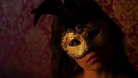 mysterious woman in a golden Venetian mask