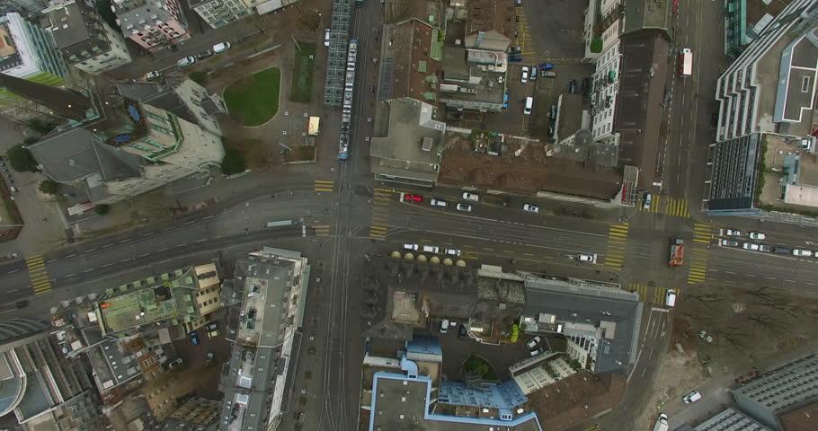 Timelapse drone shot straight down onto busy Stauffacher place in Zurich. #1013770949