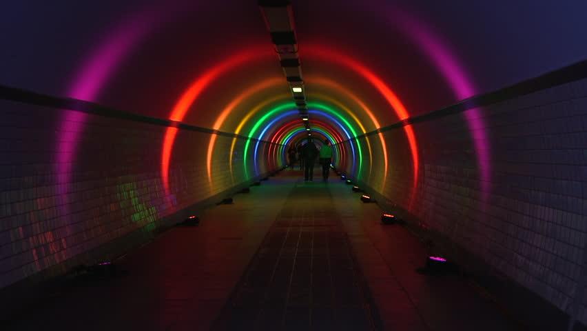 Antwerp, Belgium - 06 11 2018: People walking through pedestrian tunnel in Antwerp on Juin 12 2018, lighted in rainbow colours for gay,lesbian awareness | Shutterstock HD Video #1013785139