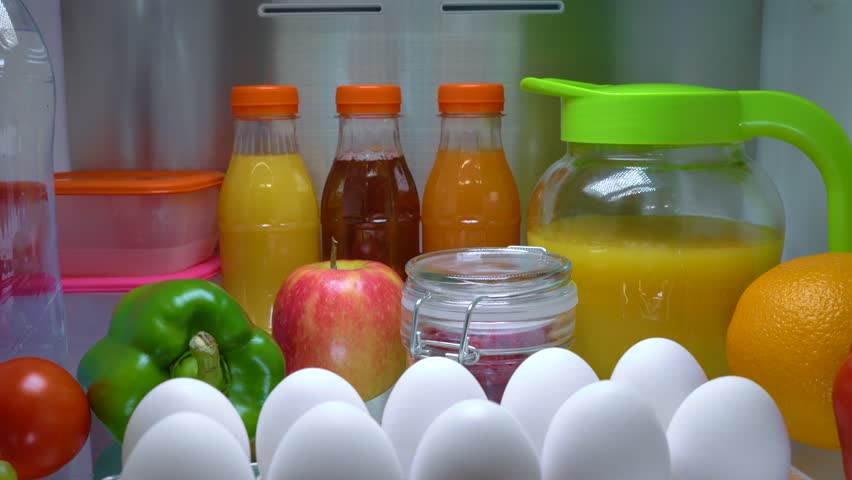 Open refrigerator filled with food. Healthy food.   Shutterstock HD Video #1013810699