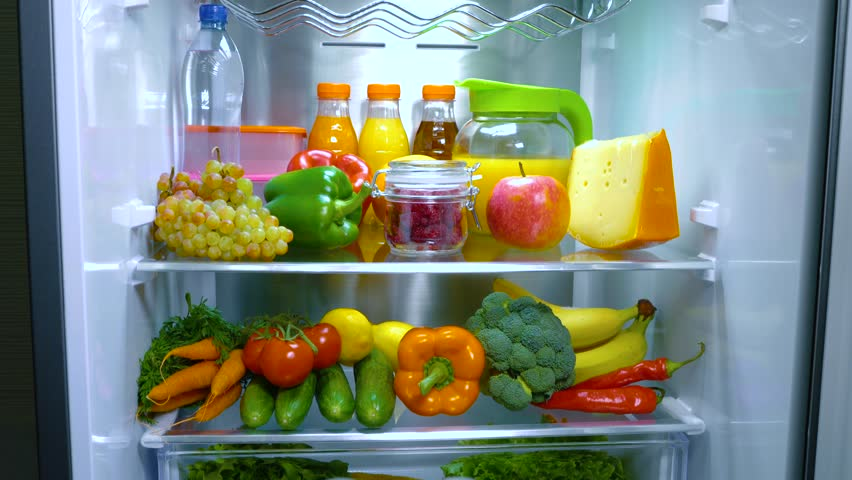 Open refrigerator filled with food. Healthy food.   Shutterstock HD Video #1013810759