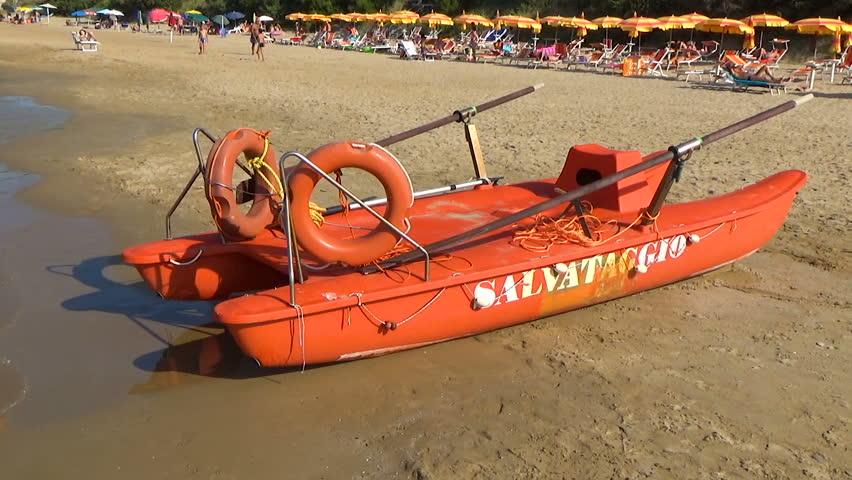 Gargano, Italy - 1 July 2018: Colored rescue boat on Italian beach. Adriatic sea. Gargano, Apulia