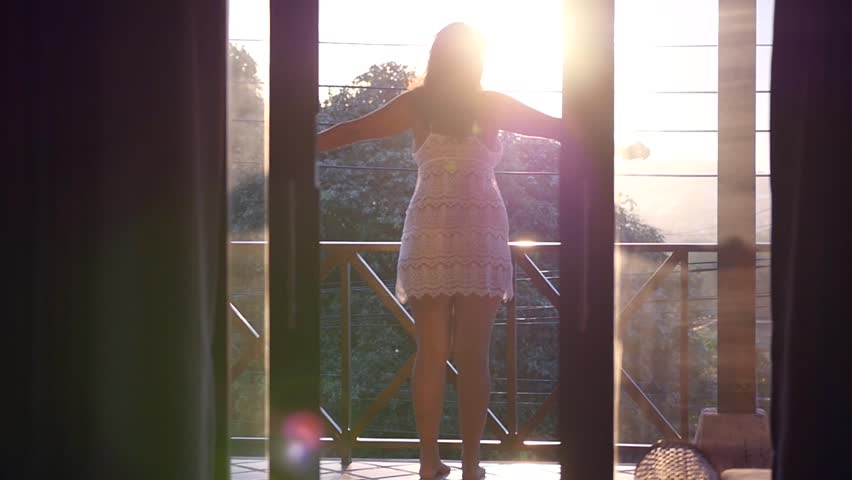 Attractive girl in a tart on a balcony. meets the dawn, pulls his hands in the reverse. Slow motion, HD, 1920x1080   Shutterstock HD Video #1013846429