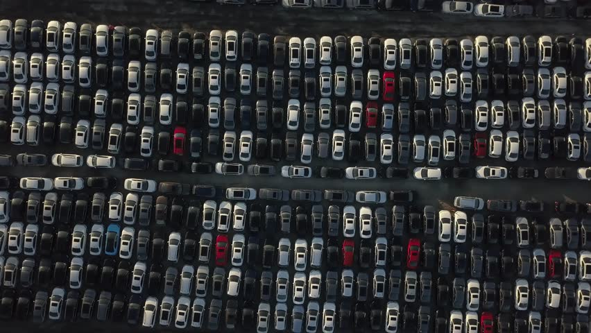 Aerial view looking down on the new cars parked at a parking lot.   Shutterstock HD Video #1013860649