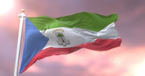 Flag of Equatorial Guinea waving at wind at sunset in slow, loop