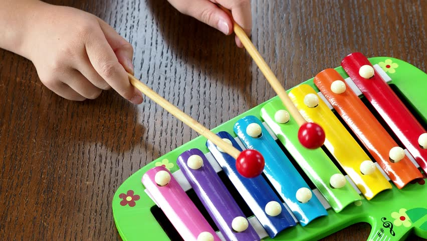 Musical instrument xylophone. Child playing on xylophone, musical instrument.  | Shutterstock HD Video #1013874269