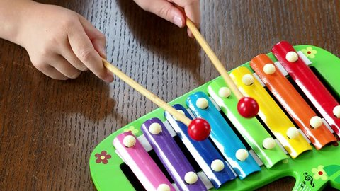 Musical instrument xylophone. Child playing on xylophone, musical instrument.
