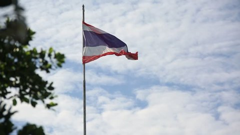 The national flags of Thailand are waving in the wind. Flags of Thailand gently waving in the wind.