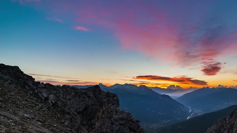 Panorama on Susa Valley (Valle di Susa) dramatic aerial view at sunrise, foggy valley, sowcapped mountain peaks, Torino Province, Italy, the Alps in summer.