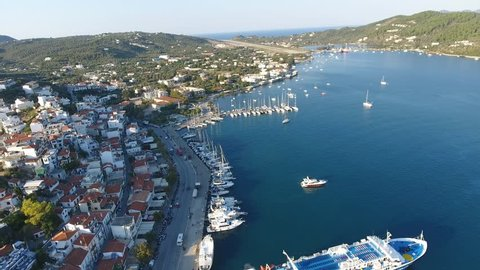 Aerial view of the port in Skiathos, Greece. Drone view of Skiathos old town and marina during sunny summer day.