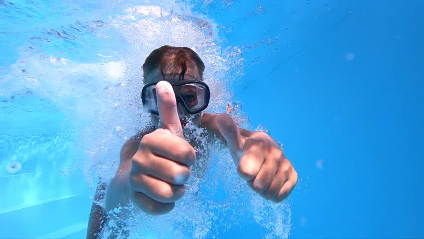 Children's games in the pool. Little, cute boy shows thumbs up under water. Slow motion. | Shutterstock HD Video #1014022619