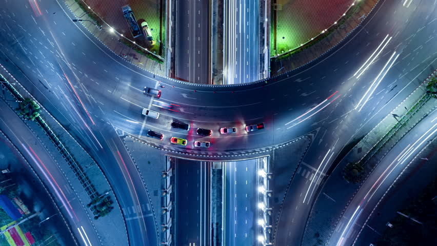 Aerial shoot top view circle road Traffic in city at night, 4K, time lapse, bangkok , thailand. | Shutterstock HD Video #1014041519