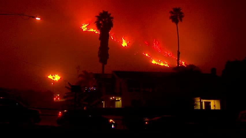 2017 - the Thomas Fire burns at night in the hills above the 101 freeway near Ventura and Santa Barbara, California.   Shutterstock HD Video #1014058439