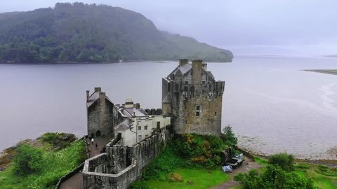 Flight over famous Eilean Donan Castle in the Highlands of Scotland - aerial drone footage