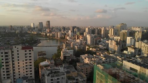 Aerial drone shot of Dhaka showing densely packed buildings during beautiful sunset