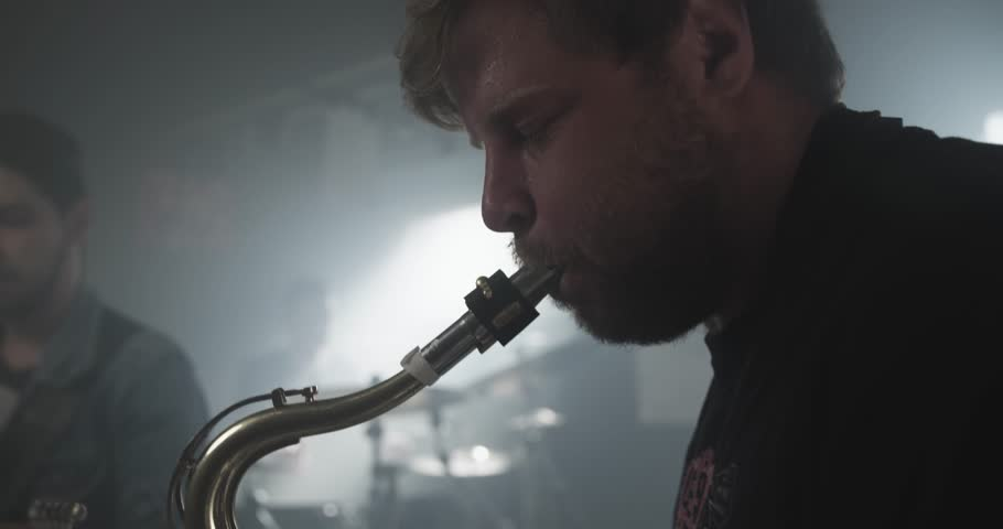 Musician is playing saxophone