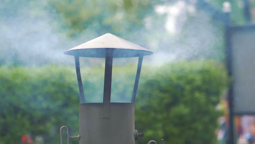 Smoke coming out of the chimney in a house | Shutterstock HD Video #1014200039