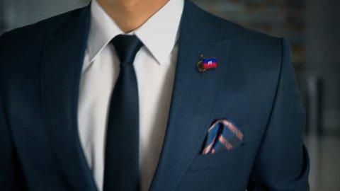 Businessman Walking Towards Camera With Country Flag Pin - Haiti