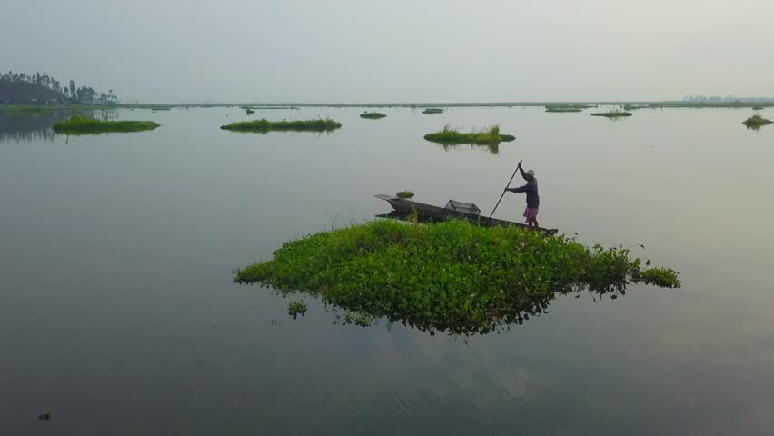 Fisherman on a boat at Loktak Lake