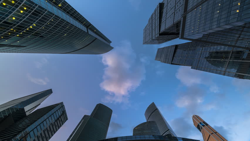 Stock video of bottom up view of rotating skyscrapers and 4k0014 moscow russia circa july two thousand eighteenth year bottom up view of rotating skyscrapers and flying cloudstime lapse hyper lapse ccuart Images