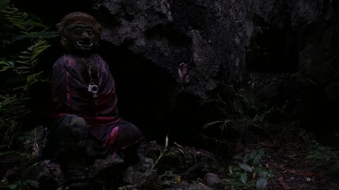 Scary and frightening statue in middle of the jungle in a dark and gloomy atmosphere, forest spirit in Thailand