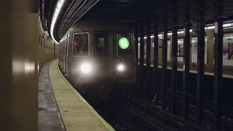 New York City subway train arriving to the underground statio