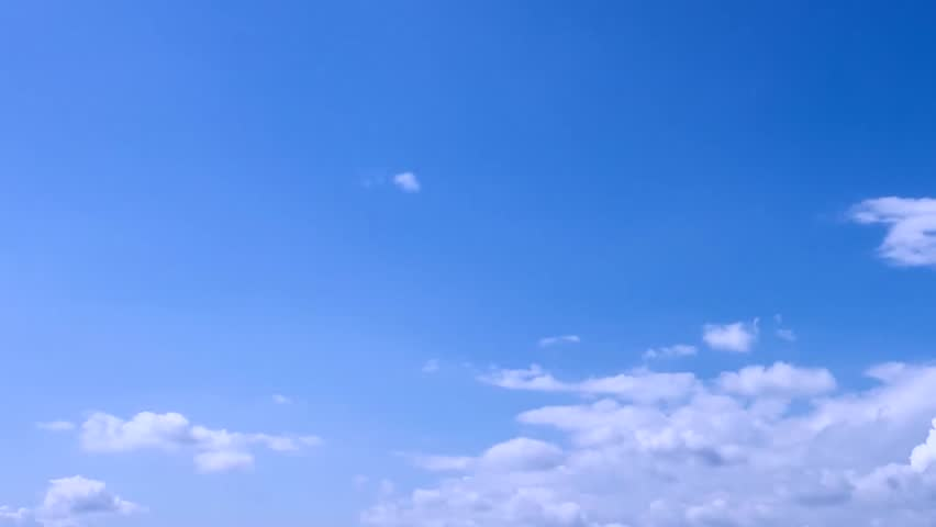 White building clouds time lapse, blue soft sky in horizon, nature summer sunny day, fast motion formating cloudscape. #1014323129