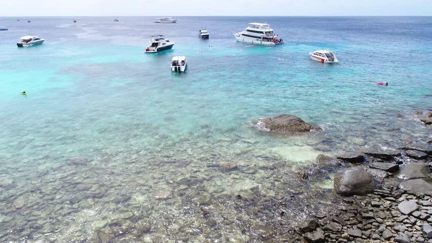 2017/08/01 02.00 p.m. Drone shot fly over speed boat tours before rain at raya island, Phuket, Thailand.