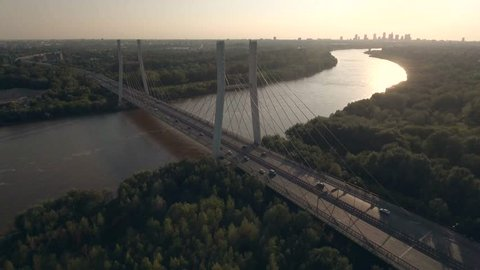 4K. aerial view Siekierkowski Bridge. city of Warsaw is Poland. beautiful sunset overlooking the bridge and the river.