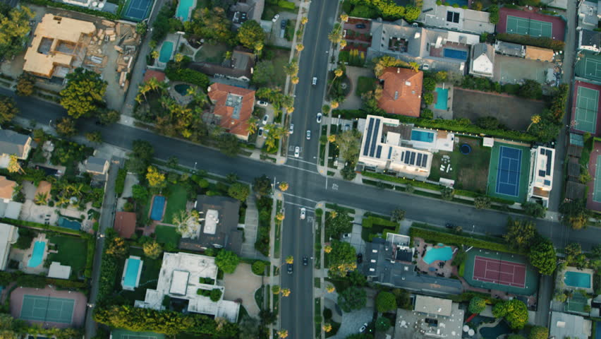 Top down aerial view of neighbourhood homes in Los Angeles, California during a summer day. Shot with a RED camera. 4k footage.
