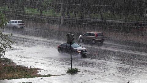 urban road transport under the stream of heavy rain