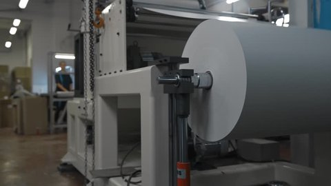 Machinery shop. Punching machine. Die cutting of paper or carton templates for disposable dishes production. Manufacturing from environmentally friendly recyclable materials. Moving parts of mechanism